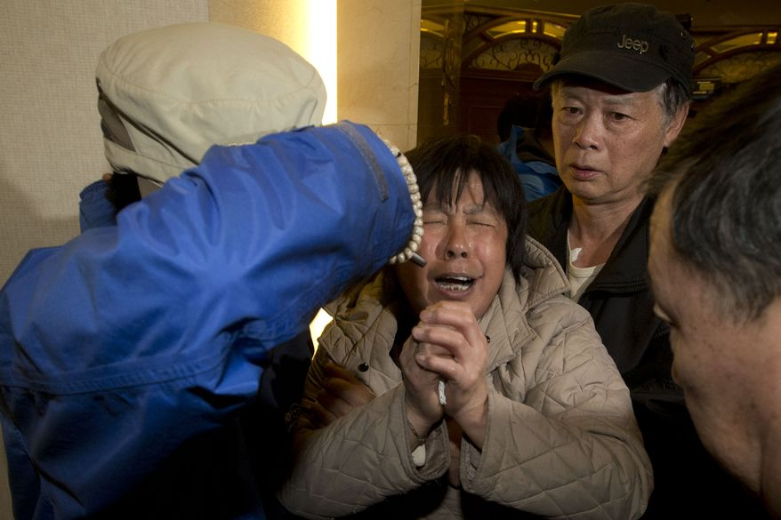 A relative of Chinese passengers aboard the Malaysia Airlines MH370, cries after being told the latest update in Beijing, China, Monday, March 24, 2014. A new analysis of satellite data indicates the missing Malaysia Airlines plane crashed into a remote corner of the Indian Ocean, Malaysian Prime Minister Najib Razak said Monday. The news is a major breakthrough in the unprecedented two-week struggle to find out what happened to Flight 370, which disappeared shortly after takeoff from Kuala Lumpur to Beijing with 239 passengers and crew aboard on March 8. (AP Photo/Ng Han Guan)