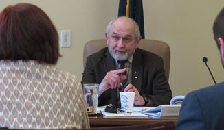 Sen. Fred Dyson, R-Eagle River, speaks during a Senate Judiciary hearing on Monday, March 24, 2014, in Juneau, Alaska, on a resolution urging the state and federal governments to seek additional money for restoration arising from the Exxon Valdez oil spill. Also shown, from left, are Sen. Berta Gardner, the sponsor of the measure, and her aide Noah Hanson. (AP Photo/Becky Bohrer)