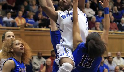 Duke's Elizabeth Williams drives to the basket over DePaul's Chanise Jenkins (13) during the first half of their second-round game in the NCAA basketball tournament in Durham, N.C., Monday, March 24, 2014.  (AP Photo/Ted Richardson)