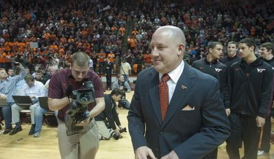 Marquette's former men's head basketball coach and now Virginia Tech's new men's head basketball coach, Buzz Williams, enters Cassell Coliseum, at an introductory press conference in Blacksburg, Virginia, Monday, March 24, 2014. (AP Photo/Roanoke Times, Don Petersen)