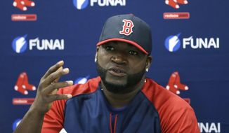Boston Red Sox designated hitter David Ortiz speaks during a news conference regarding an agreement reached with the team that all but assures the popular slugger will finish his career in Boston, Monday, March 24, 2014 in Sarasota, Fla.  Ortiz and the Red Sox agreed to a 2015 contract Sunday with options for the following two years.  (AP Photo/Carlos Osorio)