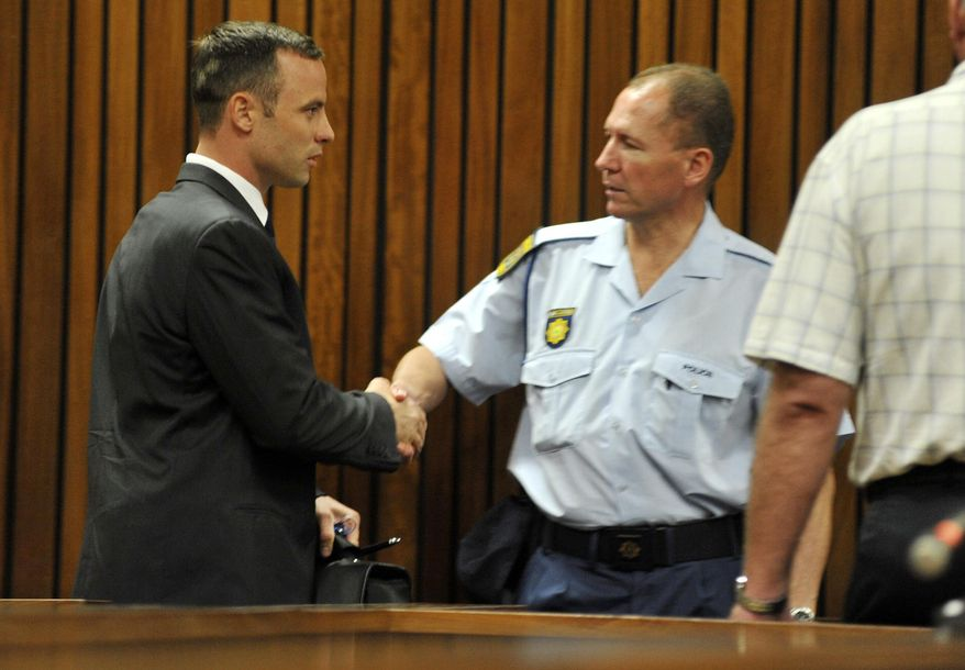 Oscar Pistorius, left, arrives at court in Pretoria, South Africa, Monday, March 24, 2014. Pistorius is on trial for the shooting death of his girlfriend Reeva Steenkamp on Valentines Day 2013. (AP Photo/Ihsaan Haffejee, Pool)