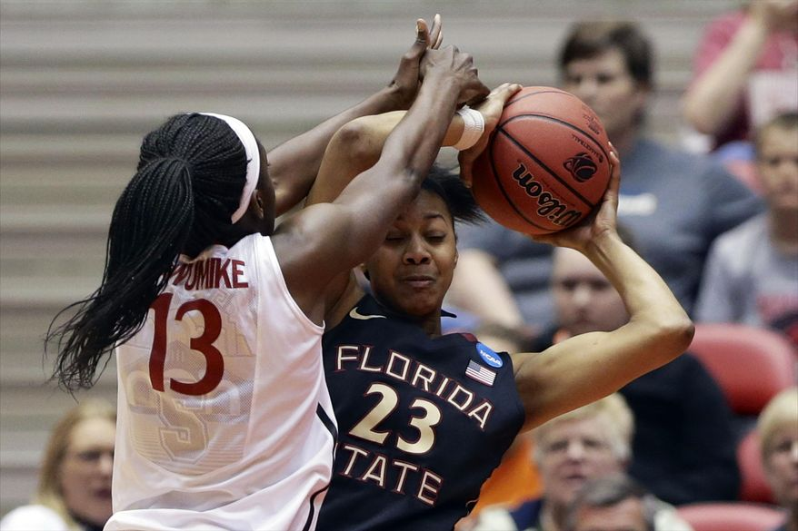 Florida State's Ivey Slaughter (23) and Stanford's Chiney Ogwumike (13) struggle for a rebound in the first half of a second-round game in the NCAA women's college basketball tournament in Ames, Iowa, Monday, March 24, 2014. (AP Photo/Nati Harnik)