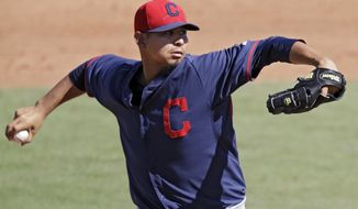 Cleveland Indians starting pitcher Carlos Carrasco delivers against the Cincinnati Reds in the sixth inning of a spring exhibition baseball game Monday, March 24, 2014, in Goodyear, Ariz. (AP Photo/Mark Duncan)