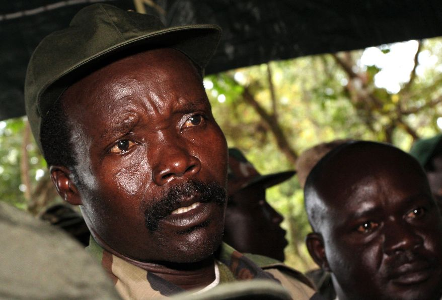 The leader of the Lord's Resistance Army, Joseph Kony answers journalists' questions following a meeting with U.N. humanitarian chief Jan Egeland at Ri-Kwamba in southern Sudan. (AP Photo/Stuart Price, Pool, File)