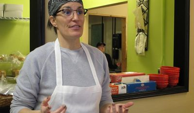 Kelley McClurkin, talks about how rising flood insurance costs will impact her bakery and deli in Findlay, Ohio on Thursday, March 20, 2014. Her bakery, which sits near a creek that flows into the Blanchard River, has been surrounded by water several times but flooded just once - in 2007 when the worst flooding in nearly a century left behind $100 million in damage. It ruined McClurkin's ovens, display cabinets and walk-in coolers. (AP Photo/John Seewer)