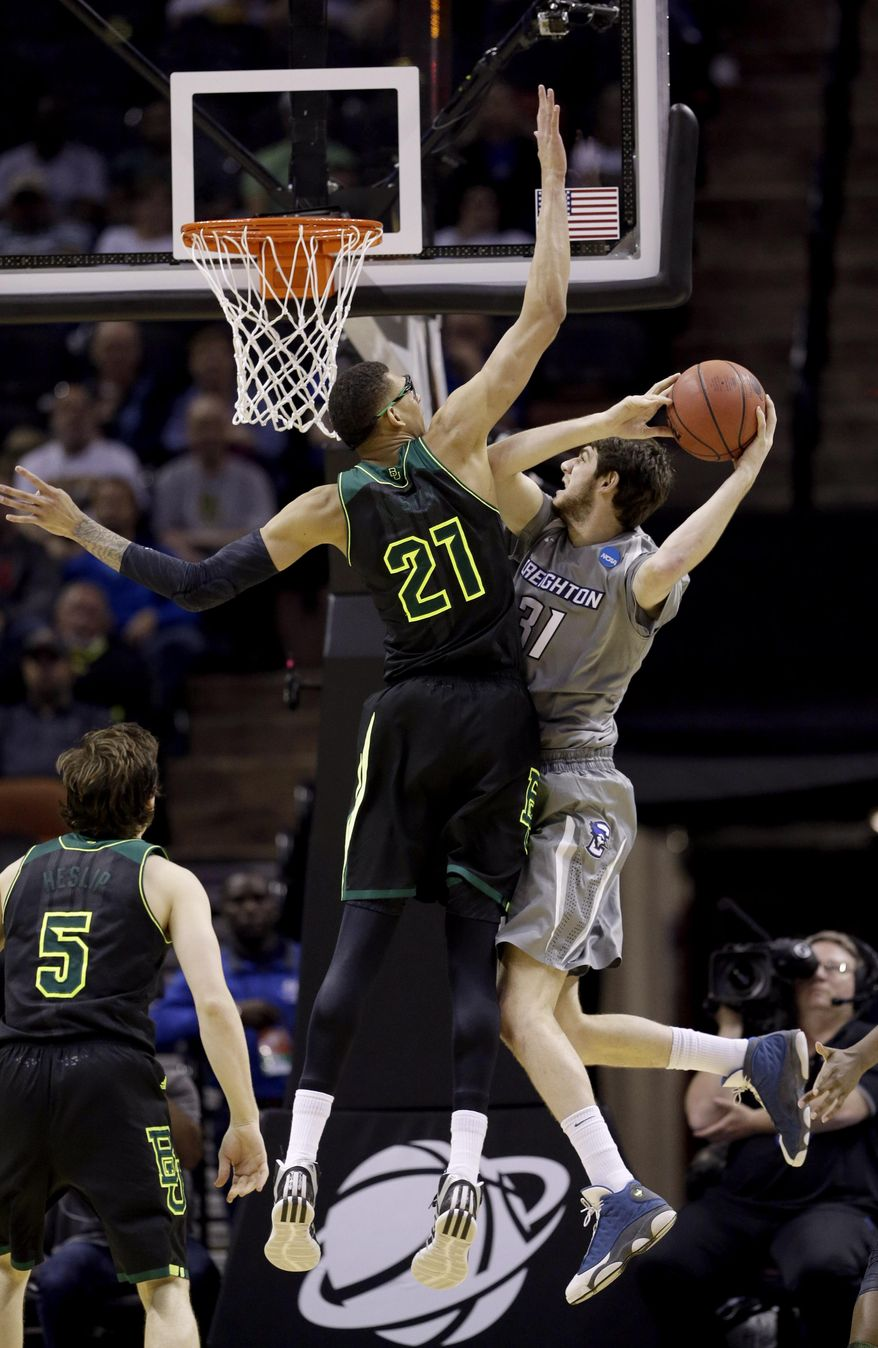 Creighton's Will Artino (31) goes up for a shot as Baylor's Isaiah Austin (21) defends during the second half of a third-round game in the NCAA college basketball tournament Sunday, March 23, 2014, in San Antonio. Baylor won 85-55. (AP Photo/David J. Phillip)