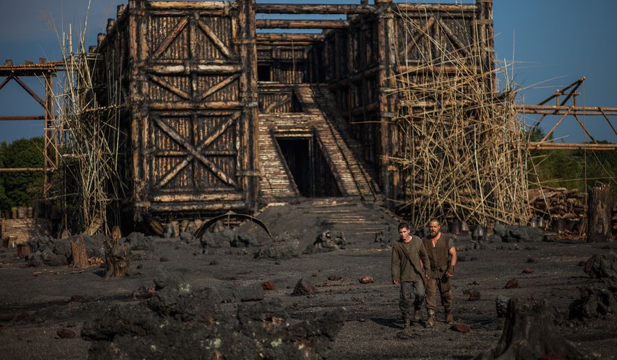 "This image released by Paramount Pictures shows Logan Lerman, left, and Russell Crowe in a scene from ""Noah."" (AP Photo/Paramount Pictures, Niko Tavernise)"