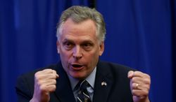 Virginia Governor Terry McAuliffe gestures during a news conference at the Patrick Henry Building in Richmond, Va.,  Monday, March 24, 2014.  McAuliffe is proposing a two-year pilot of an expanded Medicaid program, a suggestion he hopes will persuade Republicans to end an impasse over the state's budget. McAuliffe announced that the federal government said it would not penalize Virginia if it ran a two-year pilot program.  House Republicans oppose Medicaid expansion. The federal government has promised to fund the bulk of the expansion. (AP Photo/Richmond Times-Dispatch, Bob Brown).