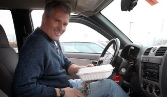 This photo taken March 22, 2014, shows former Massachusetts Sen. Scott Brown in his pick-up truck in Tilton, N.H. as he makes his way through the state. Brown is fighting to re-write political history as he tours New Hampshire. But there are early signs that the state's notoriously feisty voters may be reluctant to embrace the recent Republican transplant. Brown joined New Hampshire's U.S. Senate race roughly a week ago. He moved to the state 13 weeks ago. Brown is trying to become the third person to serve more than one state in the Senate. The last one was elected more than two centuries ago. His residency figures to play prominently in his quest to defeat Democratic Sen. Jeanne Shaheen this fall.  (AP Photo/Jim Cole)