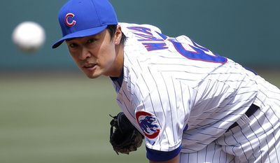 Chicago Cubs pitcher Tsuyoshi Wada, of Japan, throws against the Los Angeles Angels during the first inning of a spring training baseball game, Tuesday, March 25, 2014, in Mesa, Ariz. (AP Photo/Matt York)