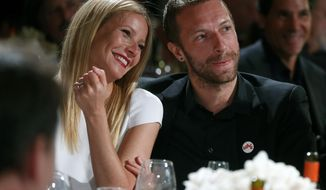"FILE - This Jan. 11, 2014 file photo shows actress Gwyneth Paltrow, left, and her husband, singer Chris Martin at the 3rd Annual Sean Penn & Friends Help Haiti Home Gala in Beverly Hills, Calif. Paltrow and Martin are separating after 11 years of marriage. A message posed on the 41-year-old actress' blog Tuesday, March 25, says that the couple has ""come to the conclusion that while we love each other very much we will remain separate."" Paltrow and the 37-year-old musician married in 2003. The couple has two children, 9-year-old daughter Apple and 7-year-old son Moses. (Photo by Colin Young-Wolff /Invision/AP, File)"