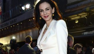 "FILE - This Oct. 18, 2012 file photo shows L'Wren Scott at the London Film Festival American Express Gala for ""The Rolling Stones - Crossfire Hurricane"", in London. Scott, a fashion designer, was found dead, Monday, March 17, 2014, in Manhattan.  Her funeral was held Tuesday, March 25, at Hollywood Forever Funeral Home in Los Angeles.  (Photo by Jon Furniss/Invision, File)"