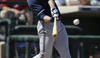 Milwaukee Brewers' Ryan Braun hits an RBI double during the first inning of a spring exhibition baseball game against the Texas Rangers Friday, March 21, 2014, in Surprise, Ariz. (AP Photo/Darron Cummings)