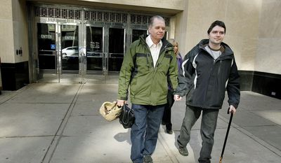 Victim Ray Widstrand was helped to his car with his parents Peter and Linda Widstrand after the 16-year sentencing of Cindarion Butler at the Ramsey County Courthouse, Tuesday, March 25, 2014 in St. Paul, Minn.  (AP Photo/The Star Tribune, Elizabeth Flores)  MANDATORY CREDIT; ST. PAUL PIONEER PRESS OUT; MAGS OUT; TWIN CITIES TV OUT