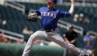 Texas Rangers' Robbie Ross throws during the first inning of a spring exhibition baseball game against the Cleveland Indians, Tuesday, March 25, 2014, in Goodyear, Ariz. (AP Photo/Darron Cummings)