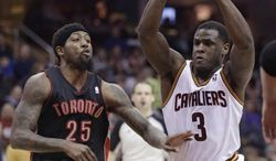 Cleveland Cavaliers' Dion Waiters (3) drives past Toronto Raptors' John Salmons (25) during the second quarter of an NBA basketball game Tuesday, March 25, 2014, in Cleveland. (AP Photo/Tony Dejak)