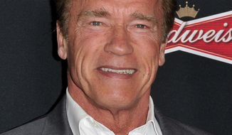"""FILE - This March 19, 2014 file photo shows actor and former California Gov. Arnold Schwarzenegger at the LA Premiere of """"Sabotage,"""" in Los Angeles. (Photo by Richard Shotwell/Invision/AP, File)"""