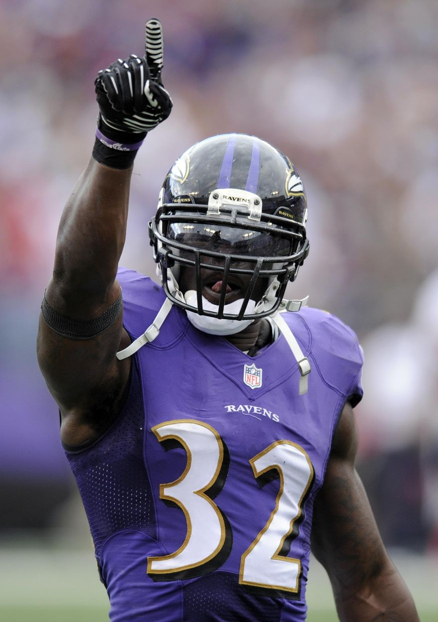 FILE - In this Sept. 22, 2013 file photo, Baltimore Ravens strong safety James Ihedigbo reacts after tackling Houston Texans running back Arian Foster in the second half of an NFL football game. A person familiar with negotiations says the Detroit Lions and Ihedigbo have agreed to a two-year contract. The person spoke Tuesday, March 25, 2014, to The Associated Press on condition of anonymity because the deal had not been announced. Ihedigbo made 99 tackles and had three interceptions for the Baltimore Ravens last year.(AP Photo/Nick Wass, File)