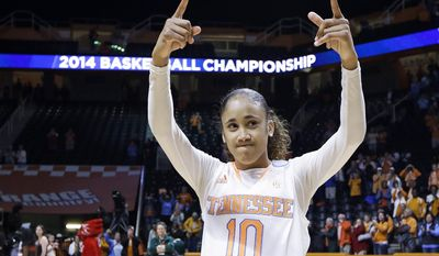 Tennessee guard Meighan Simmons acknowledges the crowd as she leaves the court following a win over St. John's in an NCAA women's college basketball second-round tournament game Monday, March 24, 2014, in Knoxville, Tenn. Simmons scored 17 points as Tennessee won 67-51. (AP Photo/Mark Humphrey)