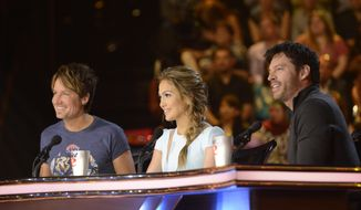 "This March 19, 2014 photo shows judges, from left, Keith Urban, Jennifer Lopez and Harry Connick, Jr. on the singing competition series ""American Idol XIII,"" in Los Angeles. (AP Photo/Fox, Michael Becker)"