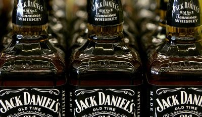 FILE - In this file photo from May 24, 2005, bottles of Jack Daniel's Tennessee Whiskey are on display at a Kansas City, Mo. liquor. State lawmakers on Tuesday, March 25, 2014, decided not to rewrite the legal definition of Tennessee whiskey this session, meaning the rules supported by Jack Daniel's will govern other distillers in the state for at least another year. (AP Photo/Charlie Riedel, File)
