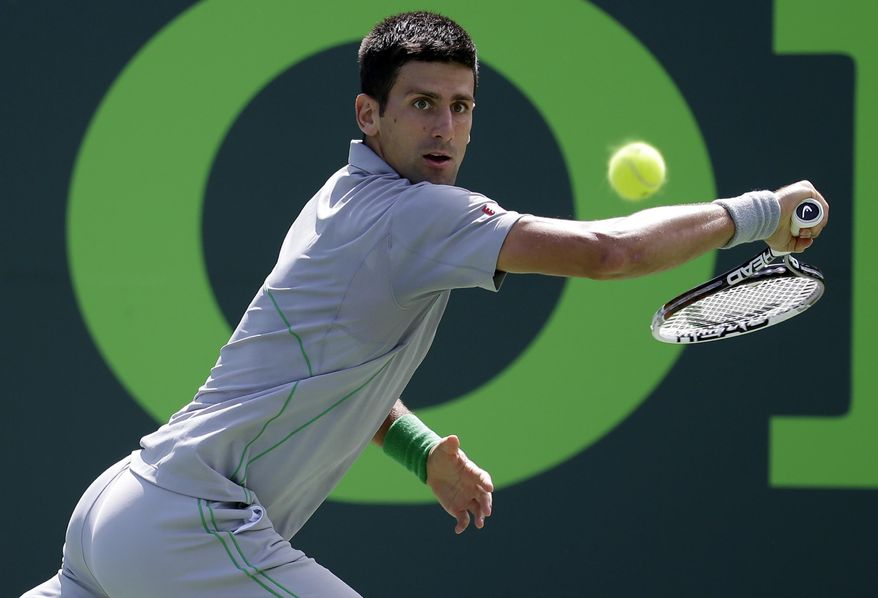 Novak Djokovic, of Serbia, returns to Tommy Robredo, of Spain, at the Sony Open Tennis tournament, Tuesday, March 25, 2014, in Key Biscayne, Fla. (AP Photo/Lynne Sladky)