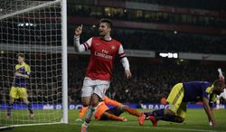 Arsenal's Olivier Giroud celebrates scoring his side's second goal during the English Premier League soccer match between Arsenal and Swansea City at the Emirates Stadium in London, Tuesday, March 25, 2014. (AP Photo/Matt Dunham)
