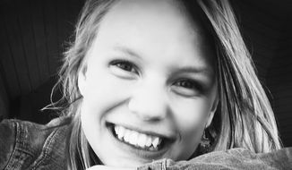 In this photo provided by Sandra Stratton is her daughter Riley Stratton. The Minnewaska, Minn., School District and Riley Stratton, represented by the American Civil Liberties Union of Minnesota, announced Tuesday, March 25, 2014 that they have settled a lawsuit that claimed school officials violated the student's constitutional rights by viewing her Facebook and email accounts without permission. The school district has agreed to pay $70,000 to settle the 2012 case involving the former Minnewaska Area Middle School sixth-grader who is now 15 years old. (AP Photo/Courtesy Sandra Stratton)