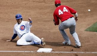 Los Angeles Angels' Ian Stewart (44) makes the catch as Chicago Cubs' Mike Olt advances safely to third base on a hit by teammate Darwin Barney during the second inning of a spring training baseball game, Tuesday, March 25, 2014, in Mesa, Ariz. (AP Photo/Matt York)
