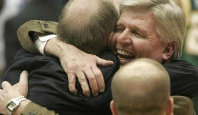 George Mason athletics director Tom O'Connor, right, hugs head coach Jim Larranaga as George Mason beat North Carolina, 65-60 in the NCAA second-round men's basketball game Sunday, March 19, 2006 in Dayton, Ohio. (AP Photo/David Kohl)