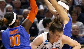 Florida's Jaterra Bonds (10) and Carlie Needles defend as Penn State's Maggie Lucas, center, tries to get between them during the first half of a second-round game in the NCAA women's college basketball tournament, Tuesday, March 25, 2014, in State College, Pa. (AP Photo/Keith Srakocic)