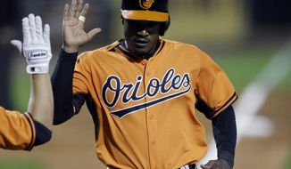 Baltimore Orioles' Adam Jones scores during the sixth inning of a spring exhibition baseball game against the Pittsburgh Pirates in Bradenton, Fla., Thursday, March 20, 2014. The Orioles won 4-2. (AP Photo/Carlos Osorio)