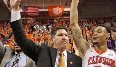 Clemson head coach Brad Brownell, left and  K.J. McDaniels celebrate with fans after their 73-68 win over Belmont in an NCAA college basketball National Invitational Tournament quarterfinal game at Littlejohn Coliseum in Clemson, S.C., on Tuesday, Mar. 25, 2014. (AP Photo/Anderson Independent-Mail, Mark Crammer)