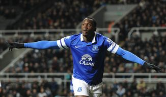 Everton's Romelu Lukaku celebrates scoring his side's second goal  against Newcastle  during the English Premier League match at St James' Park, Newcastle England Tuesday March 25, 2014. (AP Photo/Owen Humphreys/PA) UNITED KINGDOM OUT