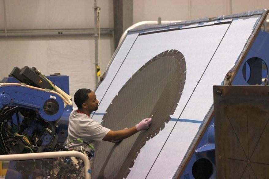 Mark Moody, an employee of Lockheed Martin Corp., works on preparations for a brace for the Dream Chaser mini-space shuttle designed by Sierra Nevada Corp. - one of three companies working on spacecraft to get NASA astronauts to and from the International Space Shuttle. Lockheed Martin also has two other, unrelated, projects at Michoud Assembly Facility in eastern New Orleans - a campus where thousands of people worked in the 1980s to build space shuttle fuel tanks. (AP Photo/Janet McConnaughey)