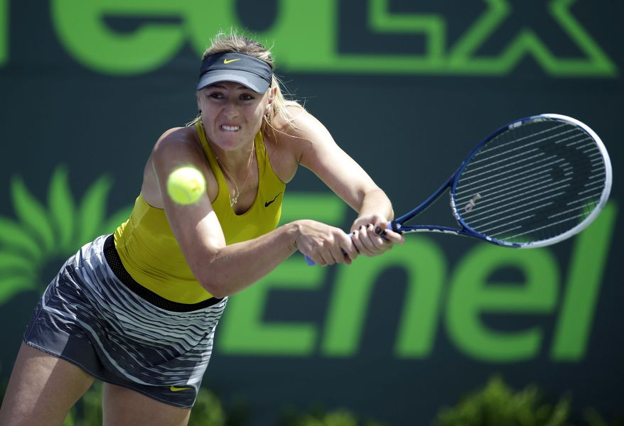 Maria Sharapova, of Russia, returns to Petra Kvitova, of Czech Republic, at the Sony Open Tennis tournament, Tuesday, March 25, 2014, in Key Biscayne, Fla. (AP Photo/Lynne Sladky)