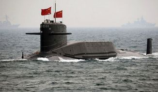 ** FILE ** China's Xia-class nuclear ballistic missile submarine. (Associated Press)