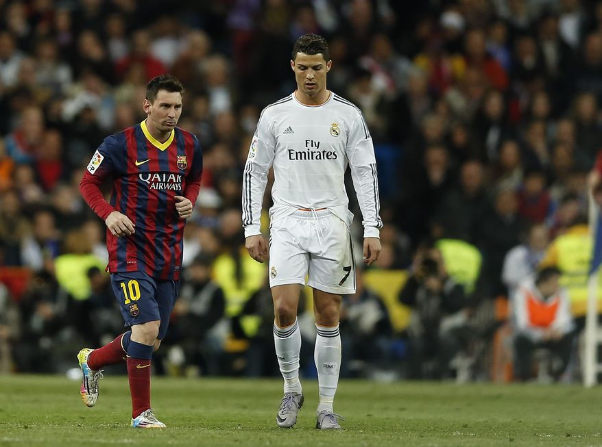 Barcelona's Lionel Messi from Argentina, left, celebrates his goal next Real's Cristiano Ronaldo, during a Spanish La Liga soccer match between Real Madrid and FC Barcelona at the Santiago Bernabeu  stadium in Madrid, Spain, Sunday, March 23, 2014. (AP Photo/Andres Kudacki)