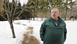 ADVANCE FOR USE SATURDAY, MARCH 29 - In this photo taken on Tuesday, March 11, 2014, Steve Dirksen poses for a photo on  his property in Clearwater, Minn. A trained forester whose philosophy is tempered by his role as a volunteer Minnesota Master Naturalist, Dirksen takes a different approach with his 28-acre forest. (AP Photo/St. Cloud Times, Jason Wachter) NO SALES