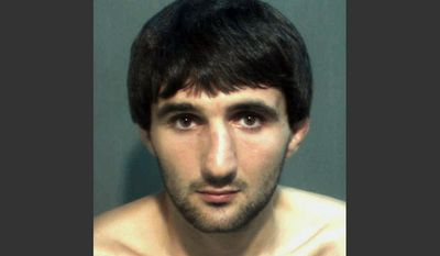 FILE-  This May 4, 2013 file photo provided by the Orange County Corrections Department in Orlando, Fla., shows Ibragim Todashev after his arrest for aggravated battery in Orlando. A report released Tuesday, March 25, 2014, determined that an FBI agent was justified in fatally shooting Todashev, who became violent after he had agreed to give a statement about his involvement in a triple slaying in Massachusetts last May.  (AP Photo/Orange County Corrections Department)