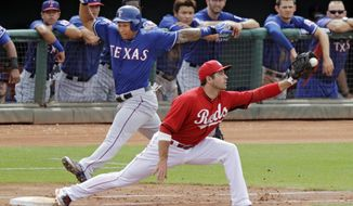 Cincinnati Reds first baseman Joey Votto, right, takes the throw to get Texas Rangers' Michael Choice at first on a ground out in the fifth inning of a spring exhibition baseball game Thursday, March 20, 2014, in Goodyear, Ariz. (AP Photo/Mark Duncan)