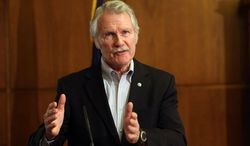 """FILE - In this March 20, 2014 file photo, Gov. John Kitzhaber speaks during a news conference in Salem, Ore. on Thursday, March 20, 2014 about the state's health insurance exchange. A state-funded audit found a failure by the exchange's managers to heed reports of problems, poor communication and what it described as """"unrealistic optimism."""" In announcing results of the audit, Kitzhaber said he was angry and disappointed in a process that had caused so much confusion and uncertainty among consumers. (AP Photo/Statesman-Journal, Kobbi R. Blair)"""