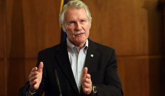 "FILE - In this March 20, 2014 file photo, Gov. John Kitzhaber speaks during a news conference in Salem, Ore. on Thursday, March 20, 2014 about the state's health insurance exchange. A state-funded audit found a failure by the exchange's managers to heed reports of problems, poor communication and what it described as ""unrealistic optimism."" In announcing results of the audit, Kitzhaber said he was angry and disappointed in a process that had caused so much confusion and uncertainty among consumers. (AP Photo/Statesman-Journal, Kobbi R. Blair)"