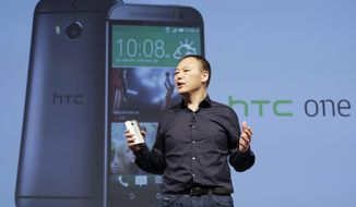 Peter Chou, CEO of HTC, introduces the new HTC One M8, Tuesday, March 25, 2014 in New York. (AP Photo/Mark Lennihan)