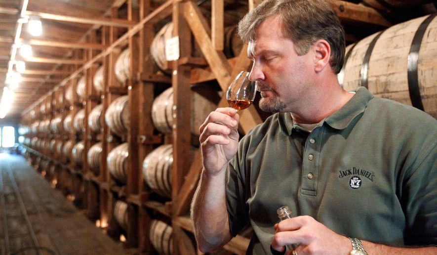 **FILE** Jeff Arnett, the master distiller at the Jack Daniel Distillery in Lynchburg, Tenn., tests the aroma of whiskey at the distillery on May 20, 2009. (Associated Press)