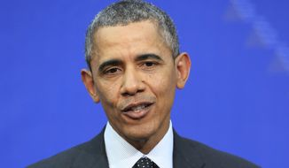 U.S. President Barack Obama addresses the media at the end of the Nuclear Summit in The Hague, the Netherlands, on Tuesday, March 25, 2014. President Barack Obama says there's no expectation that Russian forces will be dislodged from Crimea by force. (AP Photo/Yves Logghe)