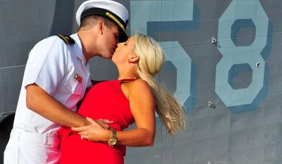 Lt. j.g. Kyle Chance kisses his wife after returning to Naval Station Mayport from a six-month deployment aboard the guided-missile frigate USS Samuel B. Roberts (FFG 58). Samuel B. Roberts deployed to the U.S. 6th Fleet Area of Responsibility in April 2013 to support maritime security operations, theater security cooperation and Operation Active Endeavor. (U.S. Navy photo by Mass Communication 2nd Class Marcus L. Stanley/Released)