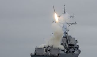 ** FILE ** The guided-missile destroyer USS Sterett (DDG 104) successfully launches its second Tomahawk missile during weapons testing. (U.S. Navy photo)
