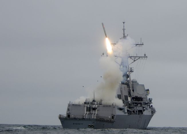 ** FILE ** The guided-missile destroyer USS Sterett (DDG 104) successfully launches its second Tomahawk missile during w